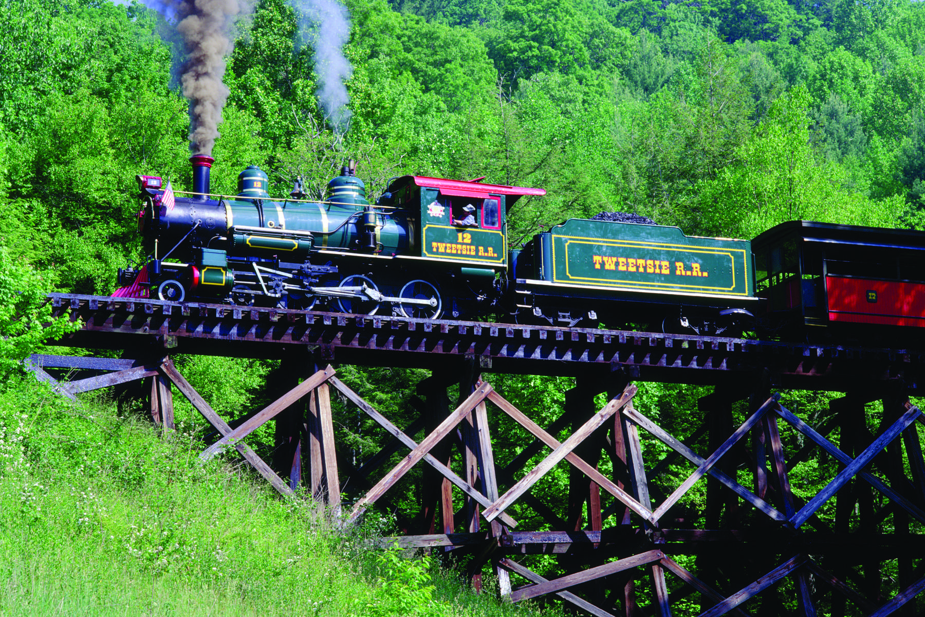Tweetsie Railroad train on trestle located just down from Mystery Hill
